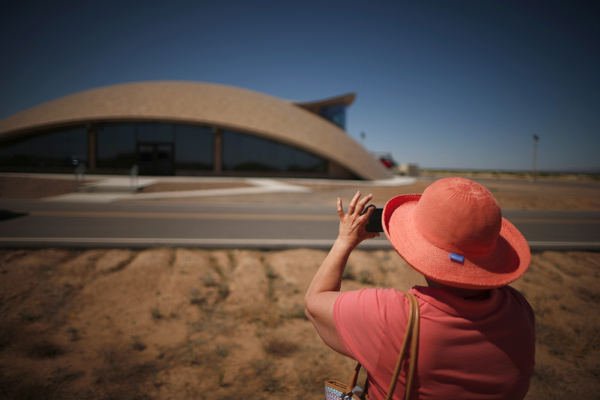 A tourist photographs Spaceport Operations Center at Spaceport America near Truth or Consequences