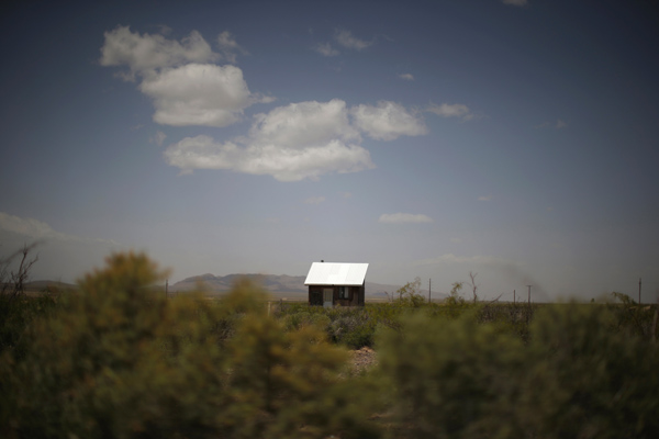 A hut is seen in the middle of a field outside Spaceport America near Truth or Consequences