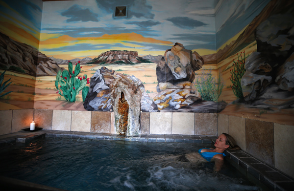 Misty McArthur, 48, from Ruidoso, NM, soaks in the hot springs at Sierra Grande Lodge & Spa in Truth or Consequences