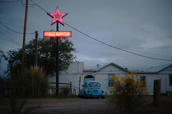 A motel displays a neon vacancy sign in Truth or Consequences