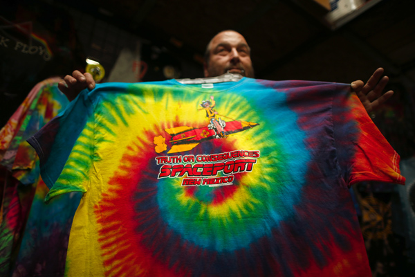 Jeff Dukatt, 59, displays a tie-dyed spaceport t-shirt he made at his store in Truth or Consequences