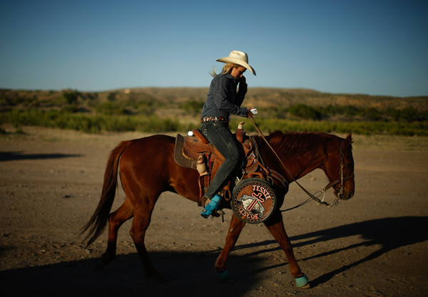 Jessie Springer, 26, rides her horse in Truth or Consequences