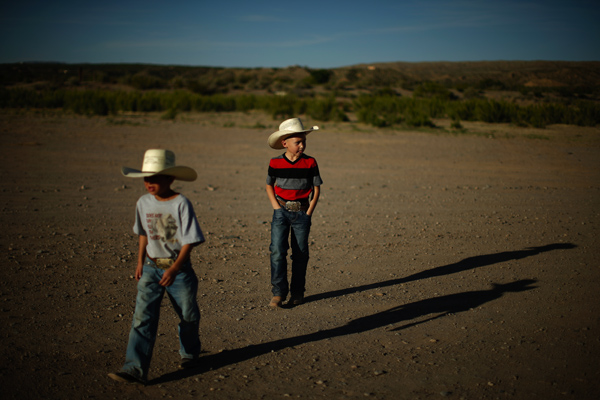 Zaryah Muller, 9, and Esteban Edwards, 7, walk in Truth or Consequences
