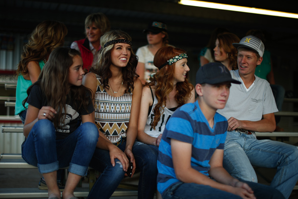 Teenagers watch the rodeo in Truth or Consequences