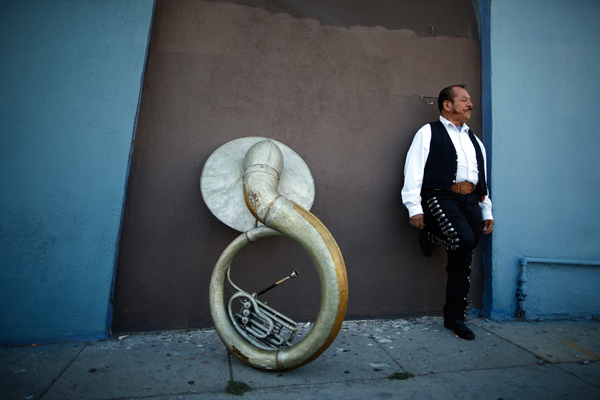 Mariachi musician Moises Rivera, 60, waits for a gig in the Boyle Heights area of Los Angeles