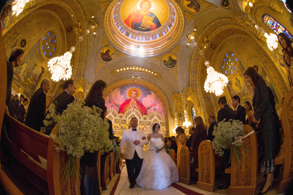 Megan Moshar, 26, who is of Persian, German and Filipino descent, marries George Safar, 27, whose parents are from Syria in Saint Sophia Greek Orthodox Cathedral in the Byzantine-Latino quarter of Los Angeles