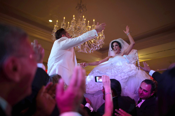 Megan Moshar, 26, who is of Persian. German and Filipino descent, dances with her husband George Safar, 27, whose parents are from Syria, at their wedding reception in Pasadena