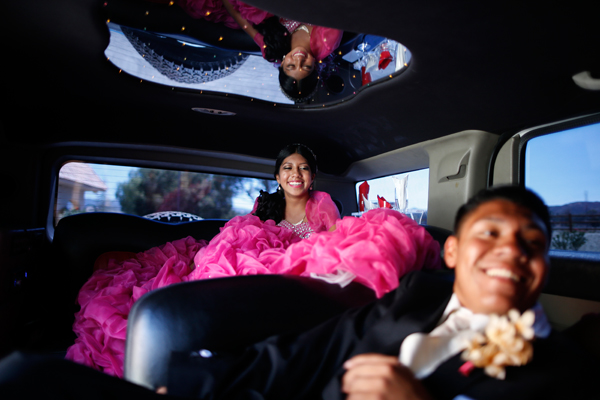 Mimi Pineda, 15, whose parents are from El Salvador, rides to church in a limousine with friend Christian Flores, 17, during her quinceanera in Santa Clarita