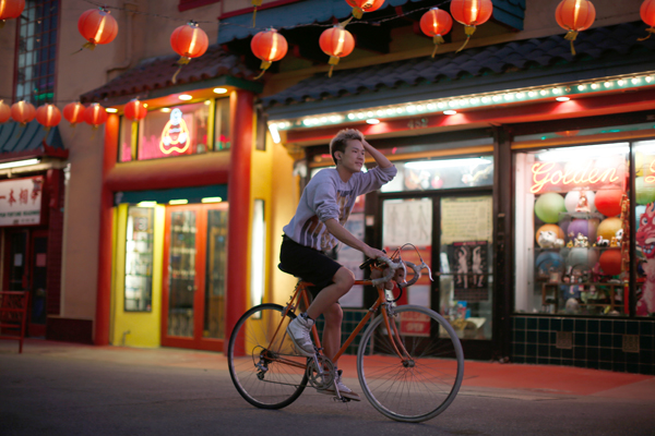 A man cycles in Chinatown in Los Angeles