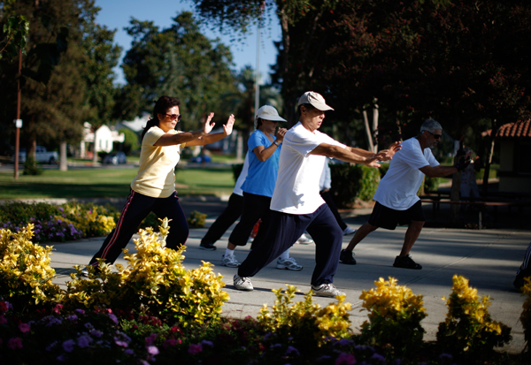 Johney Yu, 75, who emigrated from China 40 years ago, and Diana Yang who emigrated from China 28 years ago practice tai chi at a daily class in Alhambra, home of many Chinese and Vietnamese immigrants