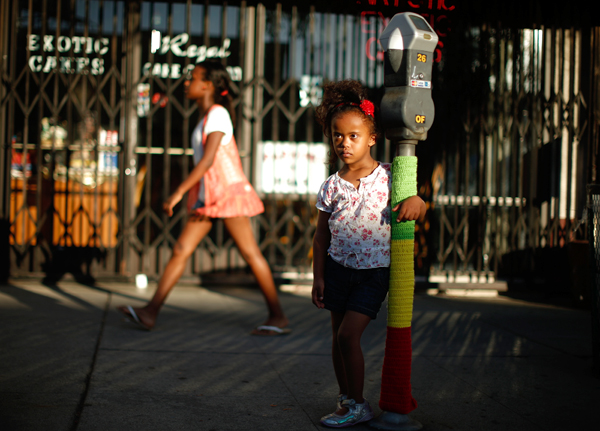Mahlet Mogas, 5, holds a parking meter decorated with wool in the colors of the Ethiopian flag in the Little Ethiopia area of Los Angeles