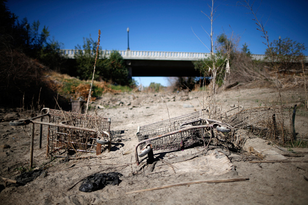 Discarded shopping carts lie in the dry Tule river bed in Porterville