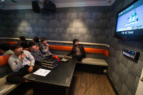 Sung Min See, 16, Jaewoong Lee, 17, Joon Kim, 16, and Jason Jung, 18, who all emigrated from Seoul, South Korea, sing in a karaoke cafe in the Koreatown area of Los Angeles