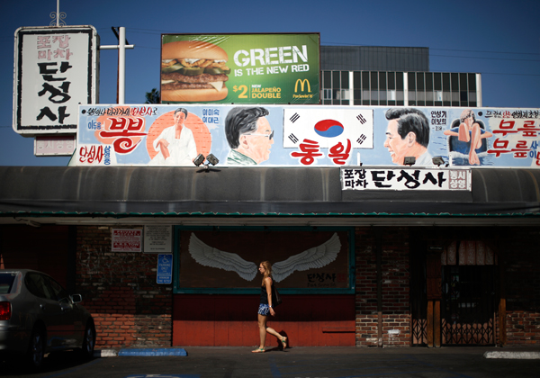 A mural depicting former North and South Korean presidents Kim Dae-jung and Kim Jong-iI either side of the South Korean flag is seen above Dan Sung Sa restaurant and bar in the Koreatown area of Los Angeles