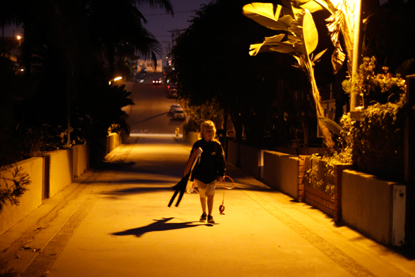 Shane Moseley, 13, arrives to meet his friends to surf before school before sunrise in Hermosa Beach, California March 31, 2015. The group of friends surf at sunrise most mornings, then shower outside and walk to school. Picture taken March 31, 2015. REUTERS/Lucy Nicholson