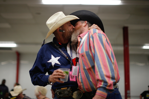 Gordon Satterly, 61, from Michigan (L) kisses his husband Richard Brand, 53, from Texas, at the International Gay Rodeo Association's Rodeo In the Rock party in Little Rock, Arkansas, United States April 24, 2015. REUTERS/Lucy Nicholson