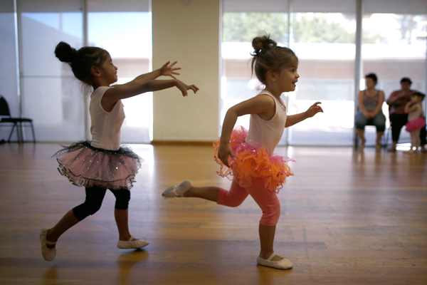 Olivia (R) and Clara, the twin three-year-old daughters of Jason Howe, 50, and his husband Adrian Perez-Boluda, 50, (not shown) chase each other in their ballet class in Los Angeles, California, United States, June 25, 2015. Howe and Perez-Boluda got married in Spain and in California in 2008. REUTERS/Lucy Nicholson