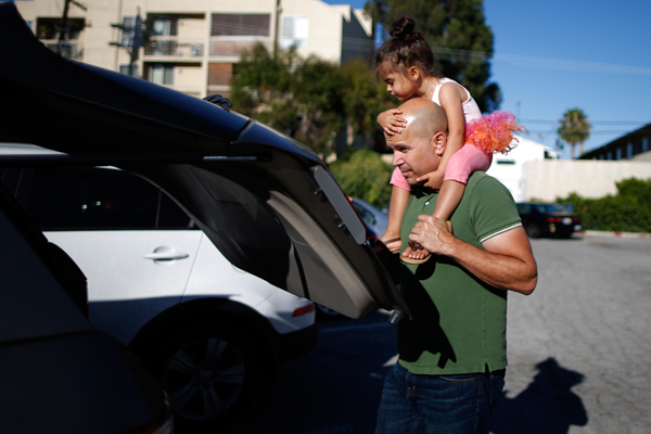 Jason Howe, 50, carries his three-year-old daughter Clara out of ballet class in Los Angeles, California, United States, June 25, 2015. Howe, 50, and his husband Adrian Perez-Boluda, 50, got married in Spain and in California in 2008. REUTERS/Lucy Nicholson