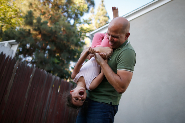 Jason Howe, 50, plays with his three-year-old daughter Olivia in their garden in Los Angeles, California, United States, June 25, 2015. Howe, 50, and his husband Adrian Perez-Boluda, 50, got married in Spain and in California in 2008. REUTERS/Lucy Nicholson