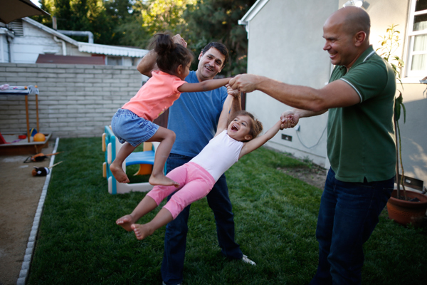 Jason Howe, 50, (R) and his husband Adrian Perez-Boluda, 50, play with their twin three-year-old daughters Olivia (2nd R) and Clara at their home in Los Angeles, California, United States, June 25, 2015. Howe and Perez-Boluda got married in Spain and in California in 2008. REUTERS/Lucy Nicholson