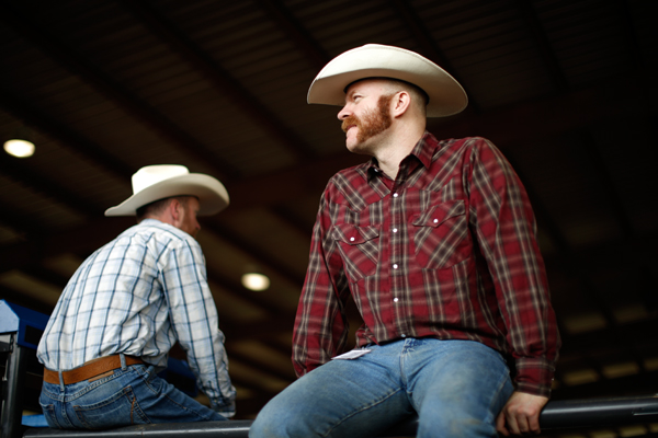 Two cowboys watch the International Gay Rodeo Association's Rodeo In the Rock in Little Rock, Arkansas, United States April 26, 2015. REUTERS/Lucy Nicholson