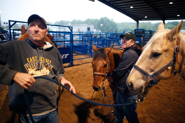 Kirk Carter, 51, (R) and his husband Shawn Eddings, 49, warm up with their horses at the International Gay Rodeo Association's Rodeo In the Rock in Little Rock, Arkansas, United States April 24, 2015. REUTERS/Lucy Nicholson
