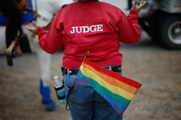 A judge gestures to a competitor at the International Gay Rodeo Association's Rodeo In the Rock in Little Rock, Arkansas, United States April 26, 2015. REUTERS/Lucy Nicholson