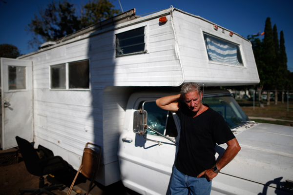 "Nathan Allen, 65, poses for a portrait in front of the RV where he sleeps in a homeless RV and tent encampment near LAX airport in Los Angeles, California, United States, October 26, 2015. Allen lost his job as a handyman, and so couldn't afford to pay the rent for his apartment. Los Angeles officials last month declared the rising problem of homelessness an ""emergency"" in the city and proposed spending $100 million to provide permanent housing and shelters to help the city's 26,000 indigent. The nation's second-largest city has nearly 18,000 individuals living on the streets, as opposed to shelters. REUTERS/Lucy Nicholson"