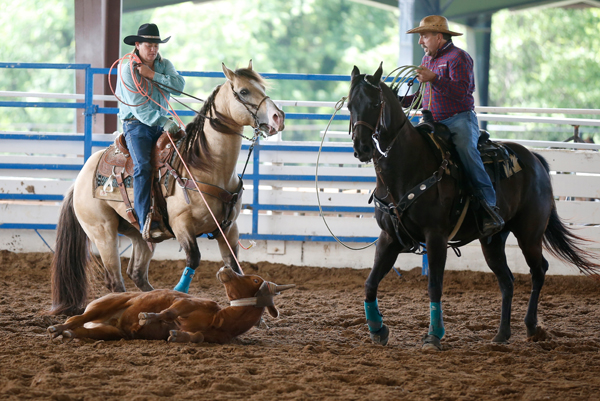 Wade Earp, 49, (R) competes in the calf roping event at the International Gay Rodeo Association's Rodeo In the Rock in Little Rock, Arkansas, United States April 25, 2015. REUTERS/Lucy Nicholson
