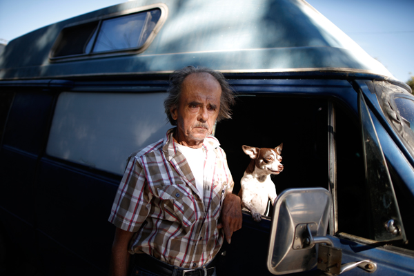 "Marvin Law, 66, poses for a portrait by the RV in which he lives on the streets of Los Angeles, California, United States, November 12, 2015. Law moved into his van 15 years ago when he couldn't afford his rent. Los Angeles officials in September declared the rising problem of homelessness an ""emergency"" in the city and proposed spending $100 million to provide permanent housing and shelters to help the city's 26,000 indigent. The nation's second-largest city has nearly 18,000 individuals living on the streets, as opposed to shelters. REUTERS/Lucy Nicholson"
