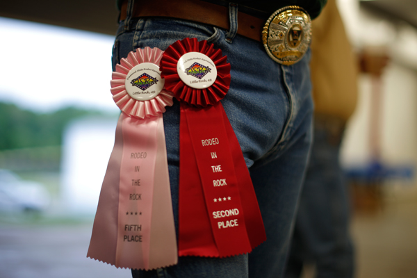 A competitor displays prize ribbons and a belt buckle at the International Gay Rodeo Association's Rodeo In the Rock in Little Rock, Arkansas, United States April 26, 2015. REUTERS/Lucy Nicholson