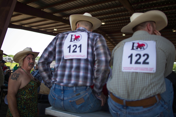 Greg Smith, 47, from Alabama (L) chats to a cowboy as he waits to compete in the Wild Drag Race at the International Gay Rodeo Association's Rodeo In the Rock in Little Rock, Arkansas, United States April 25, 2015. REUTERS/Lucy Nicholson