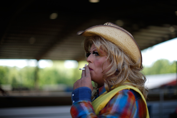 Mipsy Mikels, 50, smokes a cigarette at the International Gay Rodeo Association's Rodeo In the Rock in Little Rock, Arkansas, United States April 25, 2015. REUTERS/Lucy Nicholson