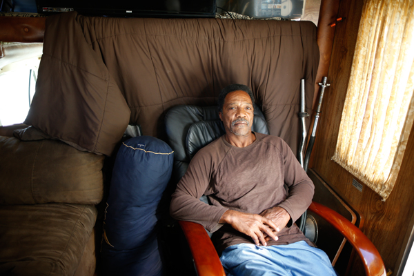 "Charles Heard, 58, poses for a portrait in the RV in which he has lived for a year on the streets of Los Angeles, California, United States, November 12, 2015. Los Angeles officials in September declared the rising problem of homelessness an ""emergency"" in the city and proposed spending $100 million to provide permanent housing and shelters to help the city's 26,000 indigent. The nation's second-largest city has nearly 18,000 individuals living on the streets, as opposed to shelters. REUTERS/Lucy Nicholson"
