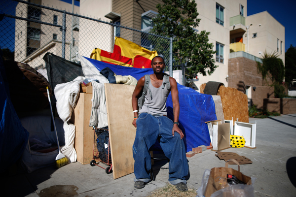 "Dontray Williams, 28, poses for a portrait by the tent in which he lives on the streets of Los Angeles, California, United States, November 13, 2015. Williams has been homeless for around five years. Los Angeles officials in September declared the rising problem of homelessness an ""emergency"" in the city and proposed spending $100 million to provide permanent housing and shelters to help the city's 26,000 indigent. The nation's second-largest city has nearly 18,000 individuals living on the streets, as opposed to shelters. REUTERS/Lucy Nicholson"