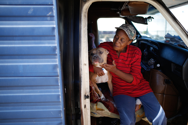 "Pamela Polk, 56, hugs her dog inside the RV in which she lives on the streets of Los Angeles, California, United States, November 12, 2015. Polk became homeless four months ago when she was evicted from her apartment, and had to borrow money from a friend to buy the RV. Los Angeles officials in September declared the rising problem of homelessness an ""emergency"" in the city and proposed spending $100 million to provide permanent housing and shelters to help the city's 26,000 indigent. The nation's second-largest city has nearly 18,000 individuals living on the streets, as opposed to shelters. REUTERS/Lucy Nicholson"