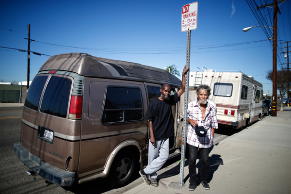 "Bernard Leatherwood, 62, (L) and his friend Arthur Johnson, 72, pose for a portrait by the RV in which they live on the streets of Los Angeles, California, United States, November 12, 2015. Leatherwood became homeless seven years ago when he became unable to afford his $1,100 a month rent. Los Angeles officials in September declared the rising problem of homelessness an ""emergency"" in the city and proposed spending $100 million to provide permanent housing and shelters to help the city's 26,000 indigent. The nation's second-largest city has nearly 18,000 individuals living on the streets, as opposed to shelters. REUTERS/Lucy Nicholson"