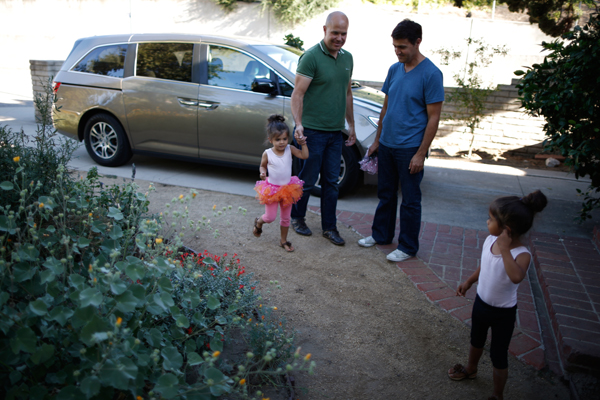 Jason Howe, 50, (2nd L) and his husband Adrian Perez-Boluda, 50, bring their twin three-year-old daughters Olivia (L) and Clara home from ballet class in Los Angeles, California, United States, June 25, 2015. Howe and Perez-Boluda got married in Spain and in California in 2008. REUTERS/Lucy Nicholson